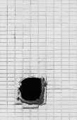 stock photo of orifice  - crack on the old tile wall  - JPG