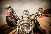 foto of motorcycle  - Motorcycle on the road with a helmet on the handlebars - JPG