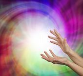 image of wicca  - Pair of female hands outstretched into a whirling vortex of light and energy - JPG