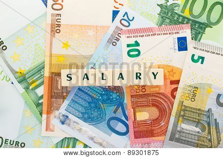 Several Euro Banknotes Salary Text Dice