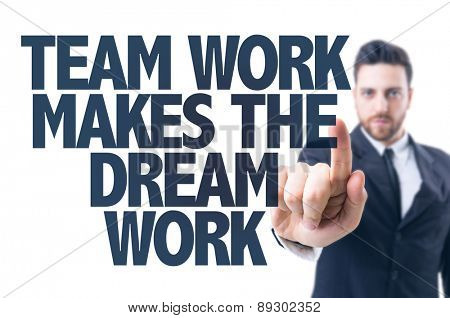 Business man pointing the text: Team Work Makes the Dream Work