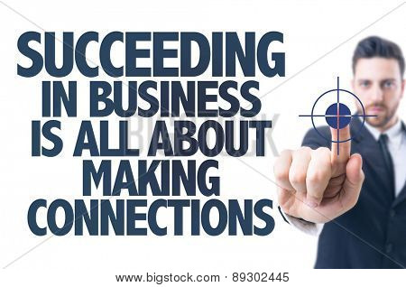 Business man pointing the text: Succeeding in Business is all about Making Connections