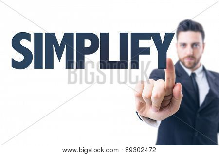Business man pointing the text: Simplify