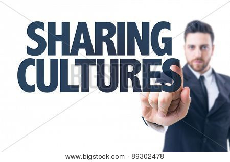 Business man pointing the text: Sharing Cultures