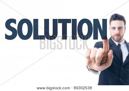 Business man pointing the text: Solution