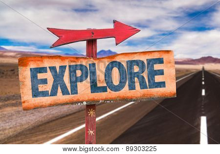 Explore sign with road background