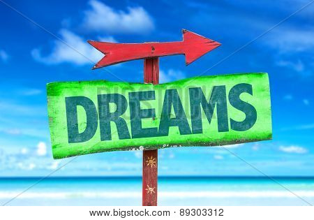 Dreams sign with beach background