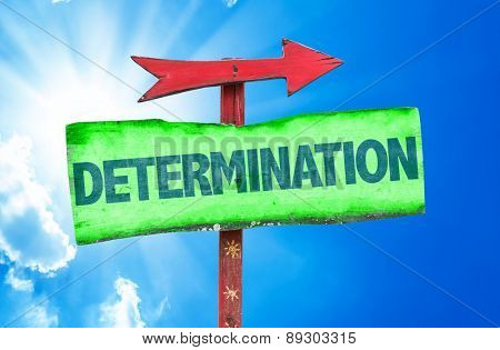 Determination sign with sky background