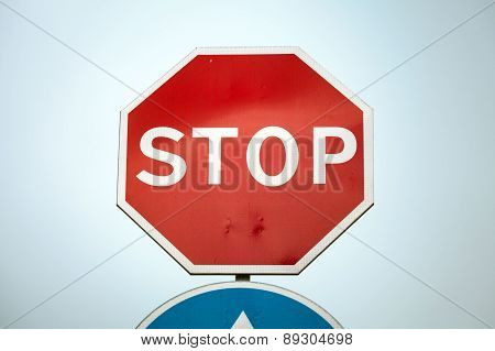 Classical Stop Road Sign Over Blue Sky