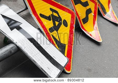Roadsigns Lay On Asphalt Road. Under Construction