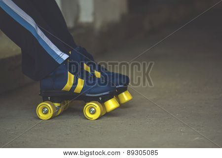 Woman Wearing Vintage Retro Quad Roller Skates