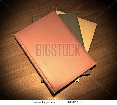 Three diaries On A Wooden Table
