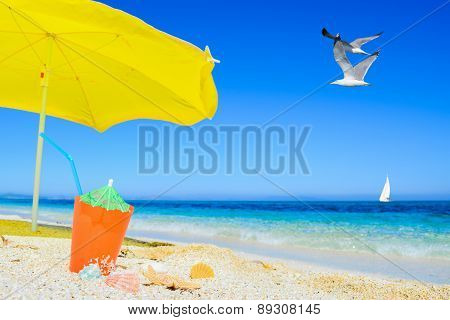 Umbrella And Cocktail Under Flying Gull