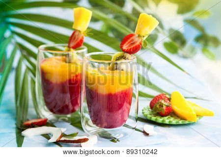 Two glasses of exotic fruit smoothie. soft focus
