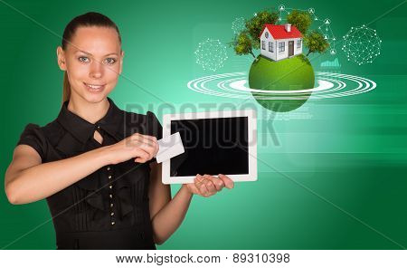Businesslady holging blank card and tablet