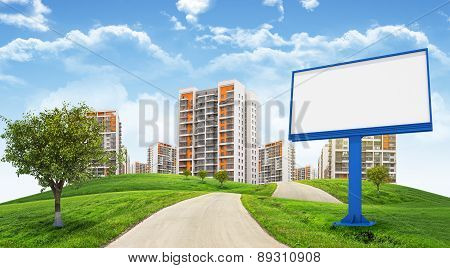 Cityscape under blue sky with blank billboard