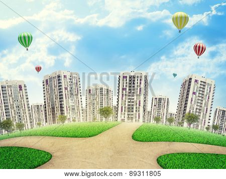 Cityscape under blue sky with ballooons