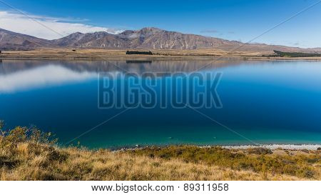 Incredibly Blue Water Of Lake Tekapo, New Zealand