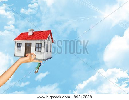 House and keys in businesswomans hand