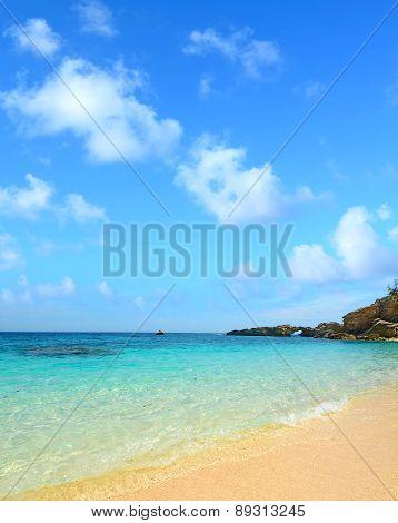 Cala Biriola Under A Blue Sky With Clouds