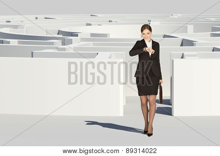Businesswoman going out from labyrinth