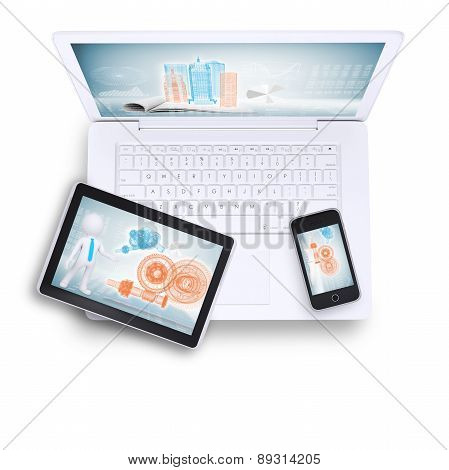 Laptop with tablet and mobile phone on, top view
