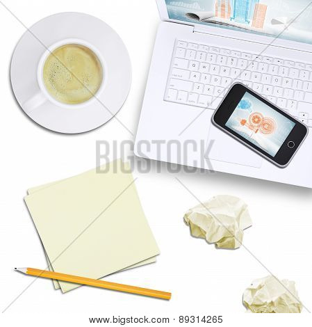 Phone on laptop with tablet and coffee