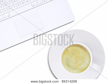 Part of laptop and coffee, top view