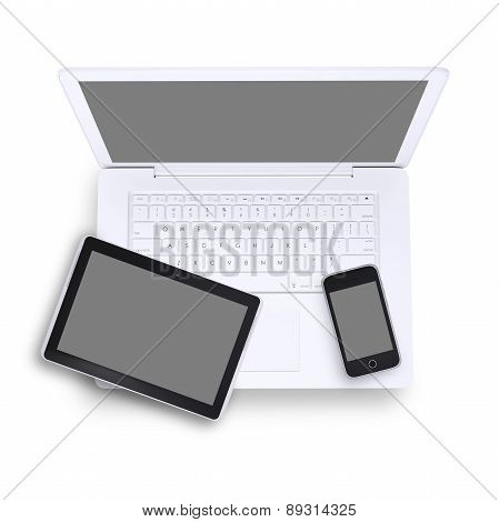 Tablet and mobile phone on laptop, top view