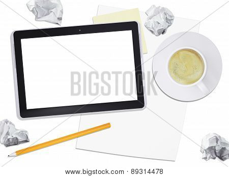 Black tablet with coffee and crumpled paper