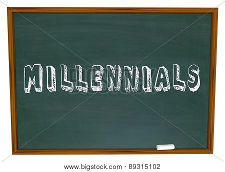 Millennials word written on a school chalkboard to illustrate young generation learning in class about social media, networking and technology