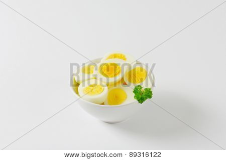 bowl of hard boiled eggs on an off-white background