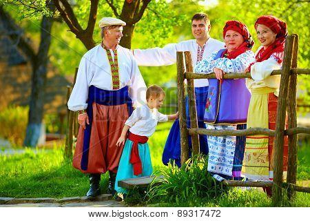 Happy Ukrainian Family In Traditional Costumes Together In Spring Garden