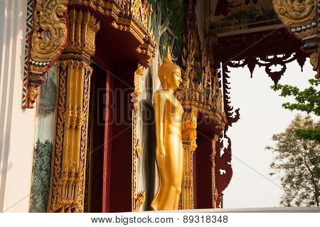 Standing Buddha Front Of Church On Thai Temple In Thailand.