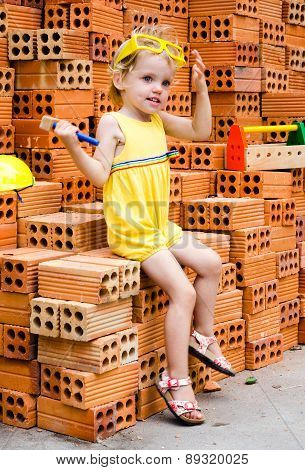 Smiling Child With Hard Hat And Construction Box
