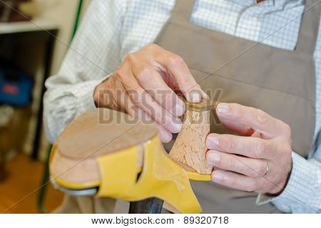 Cobbler working on a shoe heel