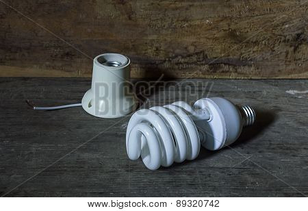 Energy Saving Fluorescent Light Bulb With Wood,still Life