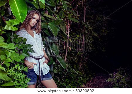 tropical garden model standing while shooting