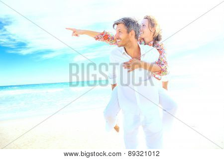 bright beach couple finger outstretched