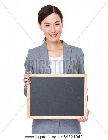 Businesswoman show with blank blackboard