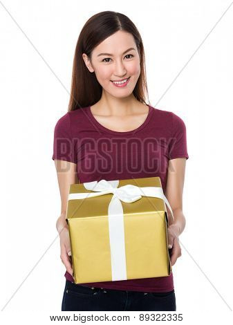 Young woman show with a big gift box