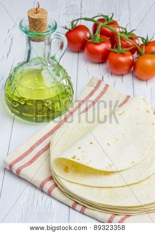 Whole Wheat Flour Tortillas With Tomatoes And Olive Oil On The Background