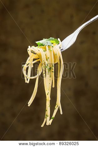 Spaghetti With Parsley Leaves Wound On A Fork