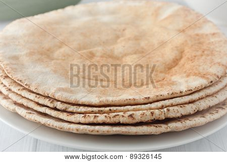 a stack of flat pita breads