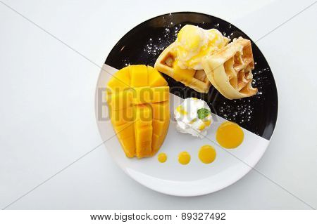 waffles with ice cream and mango