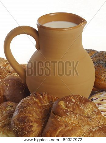 Clay Jug With Milk And Pastries Close