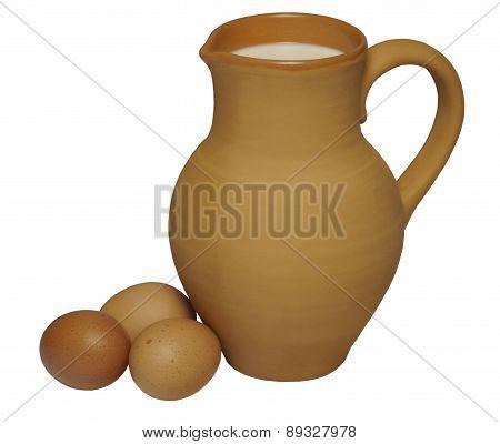 Three Chicken Eggs And Clay Jug Of Fresh Milk