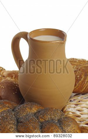 Buns With Poppy Seeds And Clay Jug With Milk