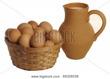 Clay Jug With Milk And A Basket Of Eggs