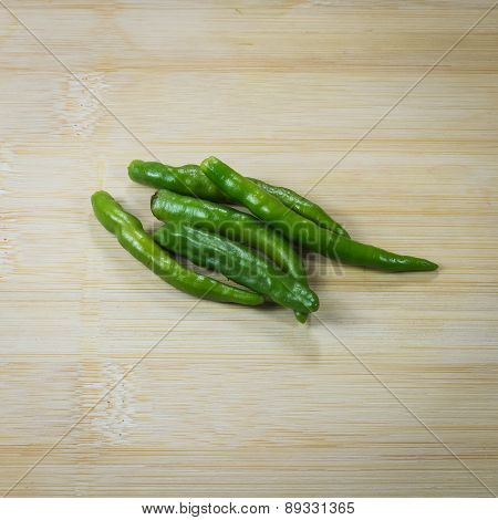 Green Peppers  On Wooden Table